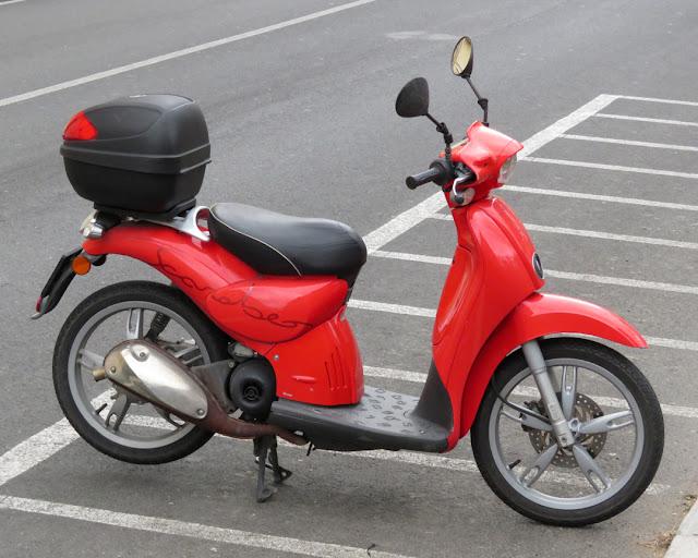 A red Scarabeo scooter, Viale del Risorgimento, Livorno