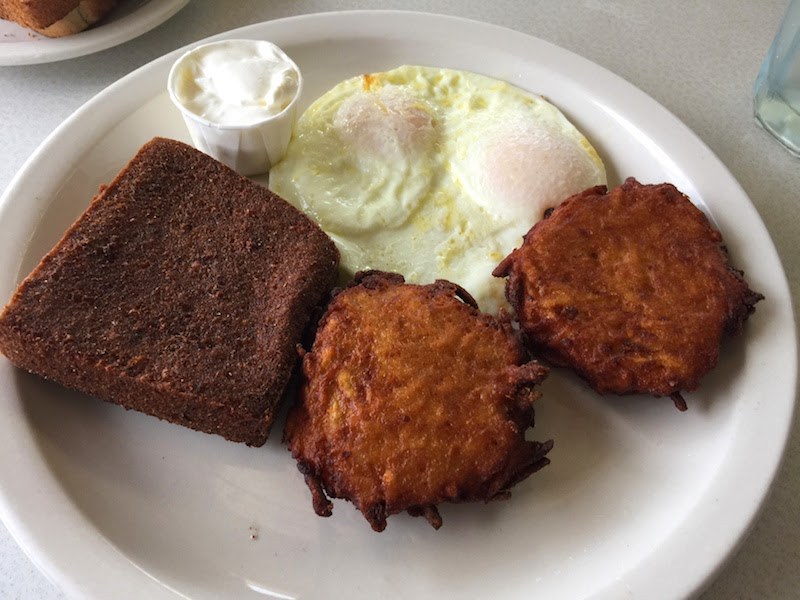 Scrapple, eggs, and potato pancakes at the Dining Car and Market in Philadelphia