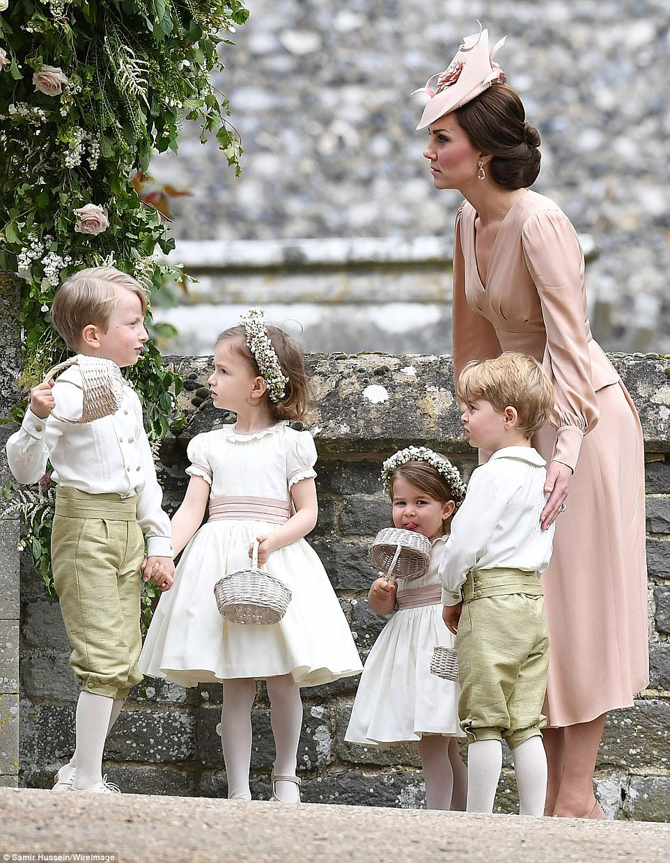 George and Charlotte were escorted by their mother the Duchess of Cambridge who was a vision in pale peach