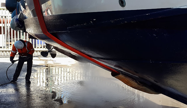 Photo of pressure washing the hull