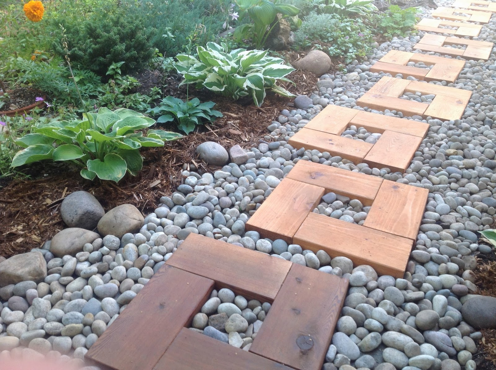 Backyard garden wood and stone path with cedar stepping stones diy pathway from stones and wood workwithnaturefo