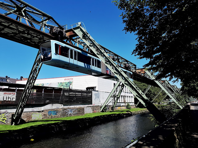 Schwebebahn gliding over the Wupper river in Wuppertal