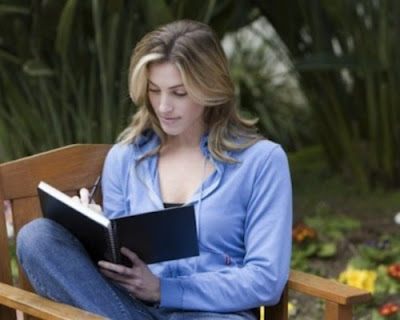 Woman reading on chair in nature