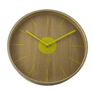 yellow and wooden modern clock