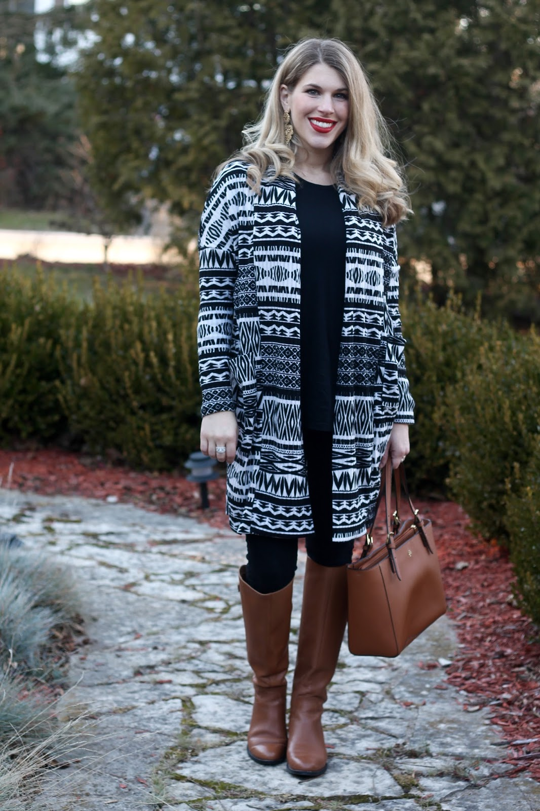 aztec cardigan, black jeans, cognac accessories, cognac riding boots