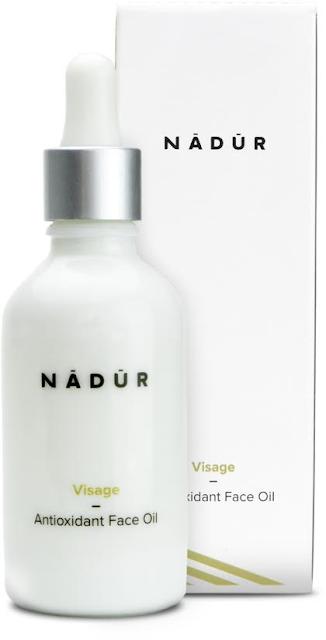 A white bottle of nadure face oil on a white bakcground.