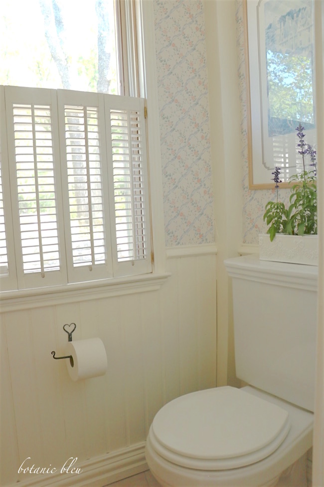 white-painted-shutters-wainscoting-posts