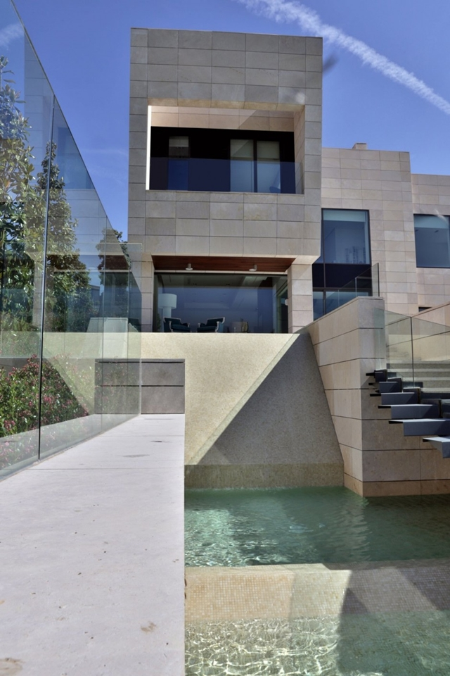 Modern stairs above the pool at The Memory House by A-Cero Architects