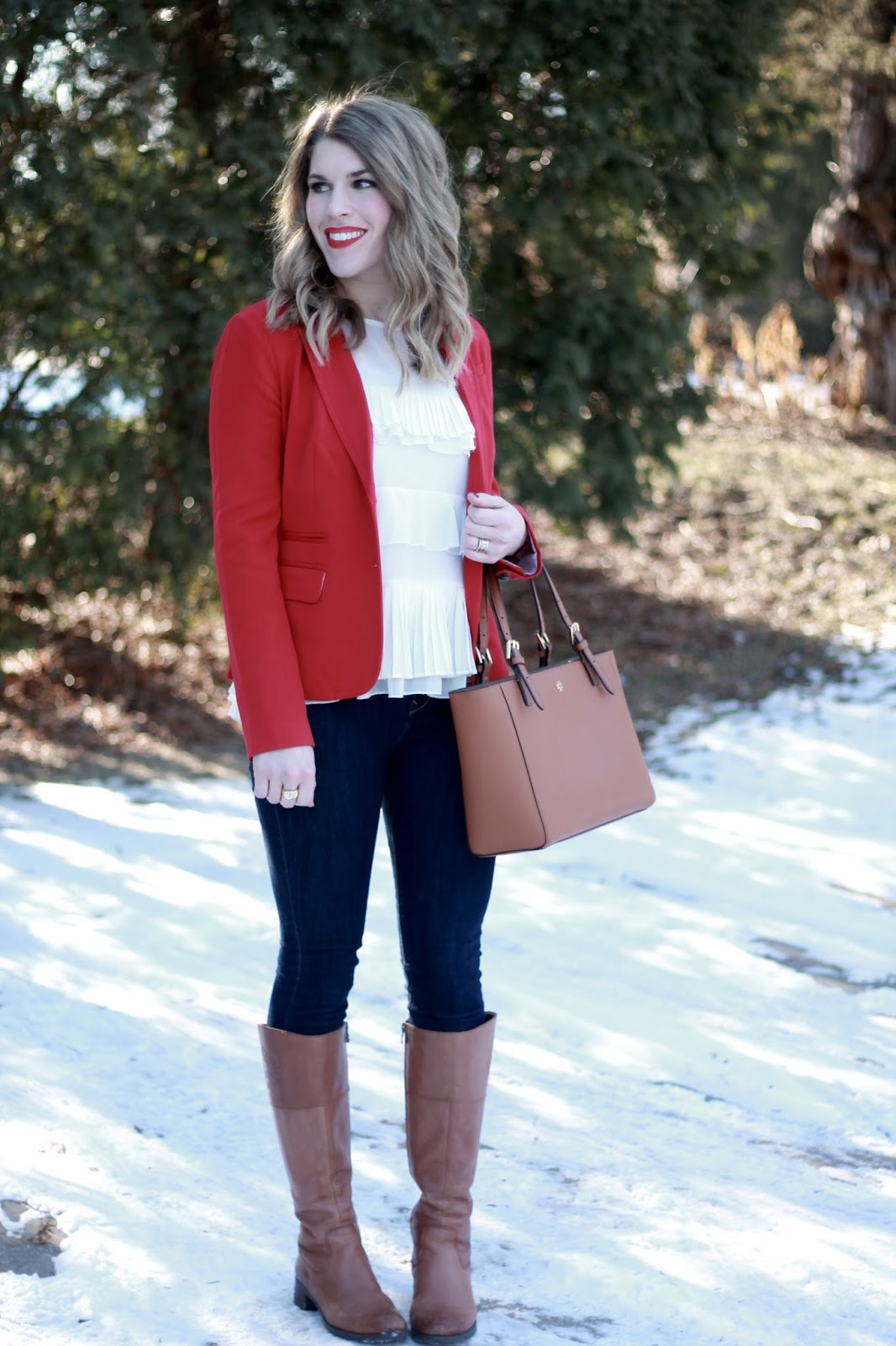 red blazer, Express dark skinny jeans, white ruffle blouse, Tory Burch tote bag, cognac riding boots