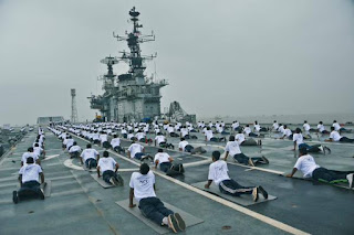 Indian Navy personnel on the expansive deck of INS Viraat.