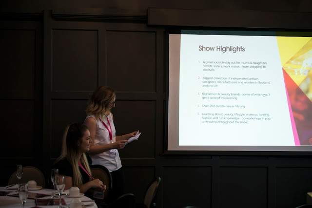 photo from the girls day out event where a representative of urban decay is giving a talk on what to expect