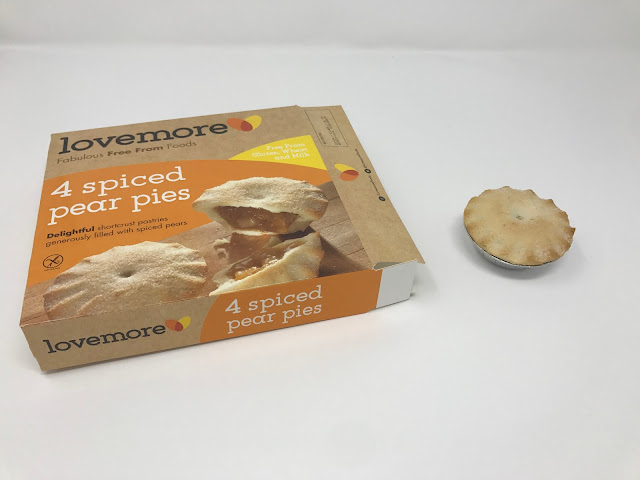 a box of lovemore spiced pear pies open next to a pie