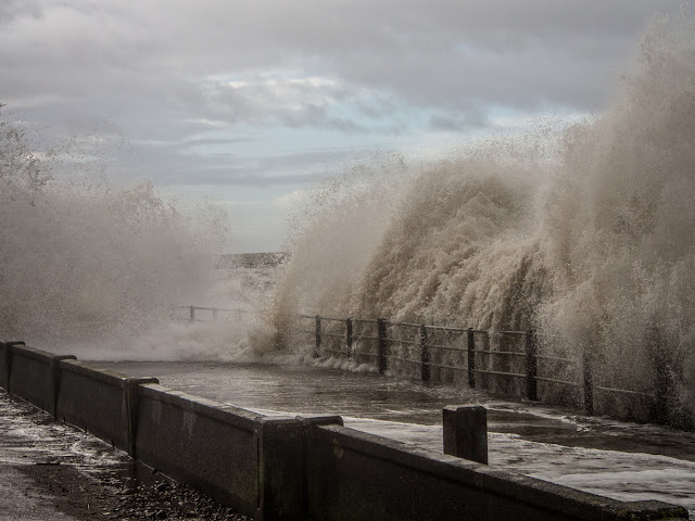 Photo of waves crashing onto the Promenade at Maryport in Cumbria, UK