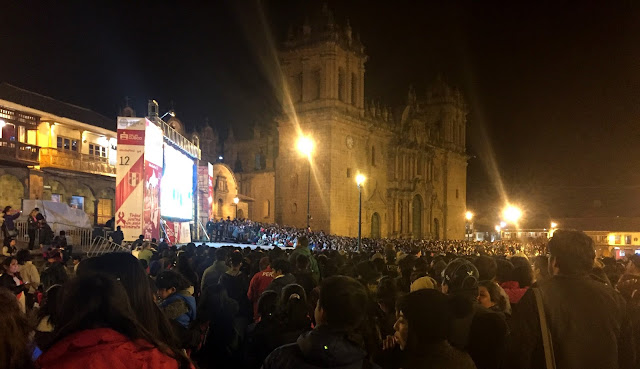 Cuzco Watches Futbol Game in Plaza