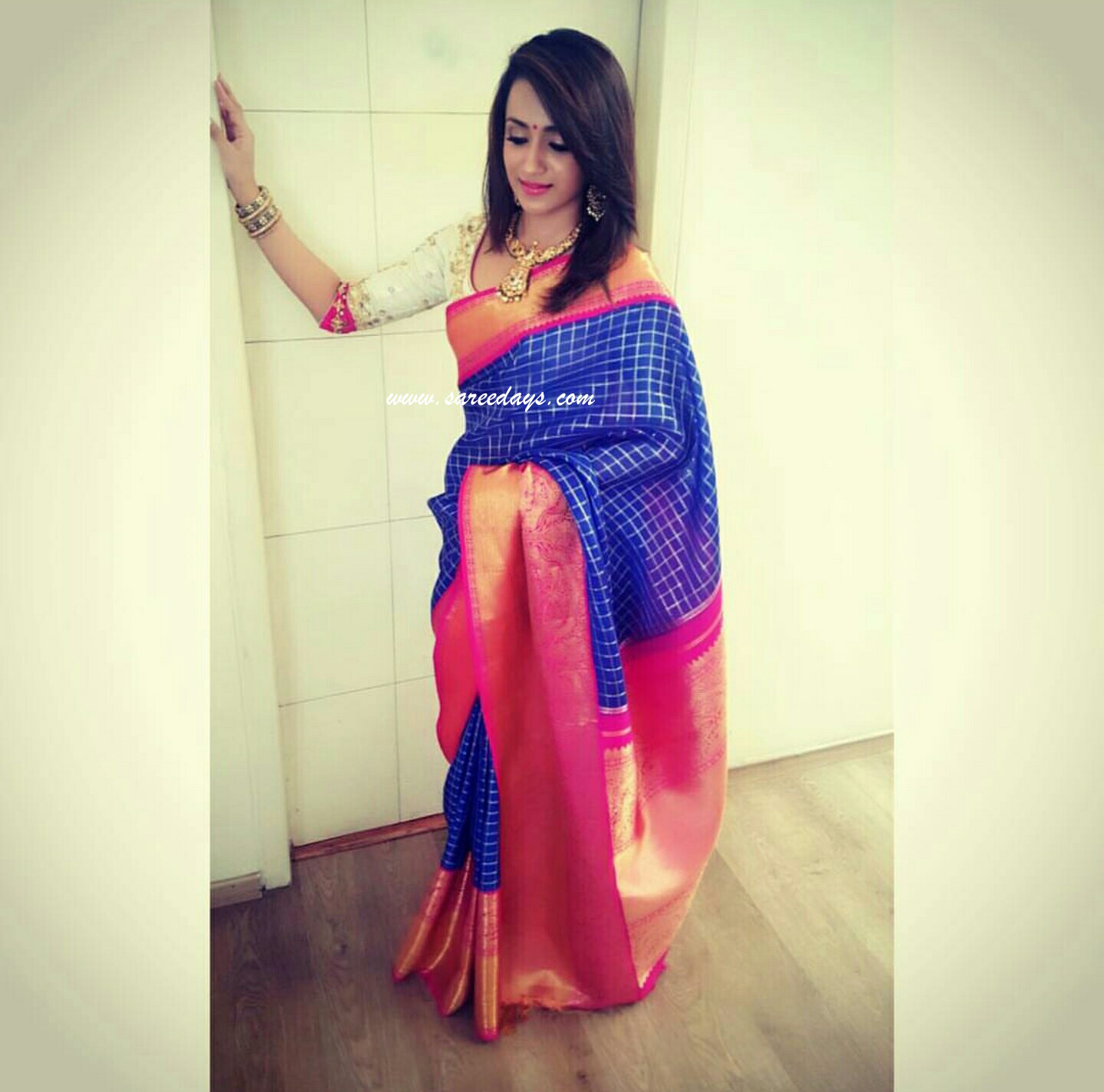 Latest saree designs 2017 checkout trisha in blue silk saree with pink zari border and zari pallu paired with contrast work half sleeves blouse altavistaventures Image collections