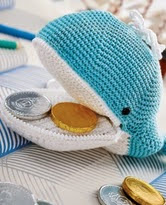 http://www.letsknit.co.uk/free-knitting-patterns/melville-the-whale-zip-purse