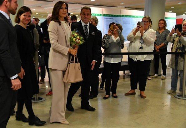 Princess carries Prada bag. Crown Princess Mary wore Massimo Dutti Pantsuit and Isabel Marant blouse