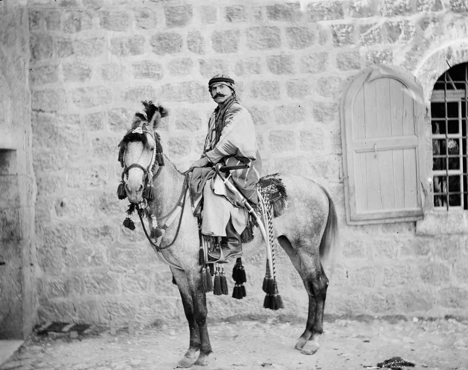 A Bedouin man poses on horseback.