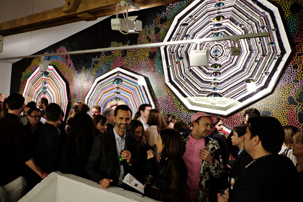 Mandala like eye 'works' and the opening night crowd at Roslyn Oxley9 gallery for 'angel dribble' by Del Kathryn Barton.