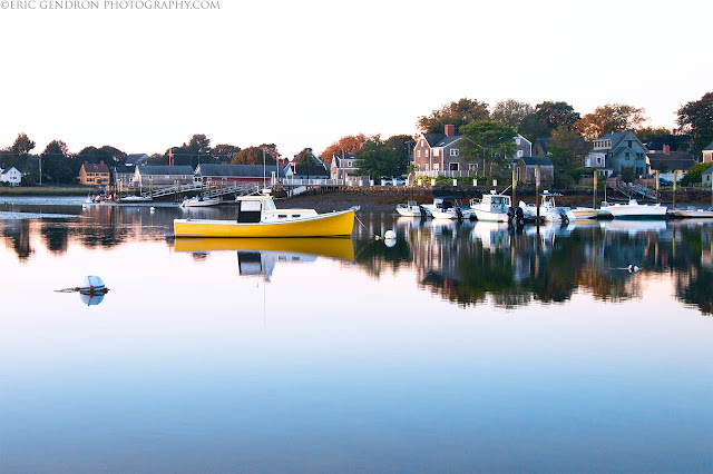 A boat at sunrise in portsmouth harbor