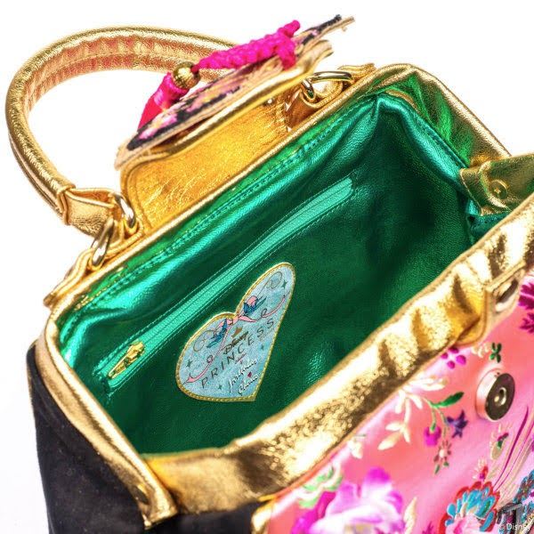 open handbag showing lining, fastenings and handle