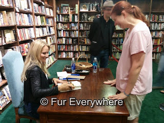 I met the singer Jewel at Tattered Cover. She is signing her book for me.