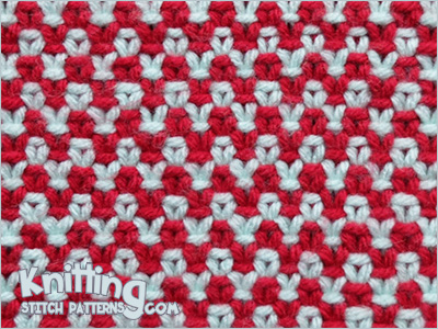 Two-color Linen stitch. It looks almost like Crochet.