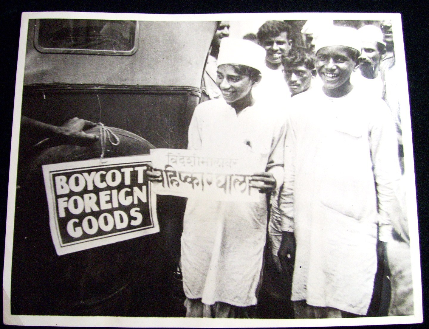 Indian Young Nationalist Affixing a Boycott Sign, to a Foreign Cart in the Streets of Bombay (Mumbai) - 1930