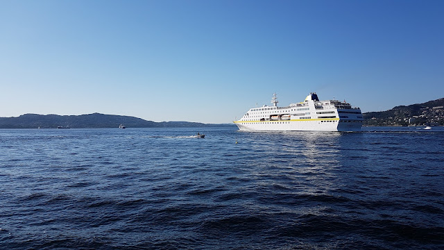 Cruise ship MS Hamburg departing a sunny Bergen, Norway