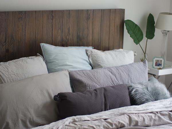 Grey and Silver Linen Bed with Too Many Pillows