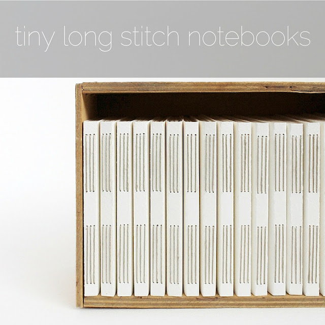 tiny white long stitch notebooks housed in an old box of Fazer's Prince Chocolate