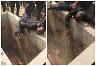 I WAN FOLLOW YOU!! Man stopped from entering his friend's grave in Bayelsa