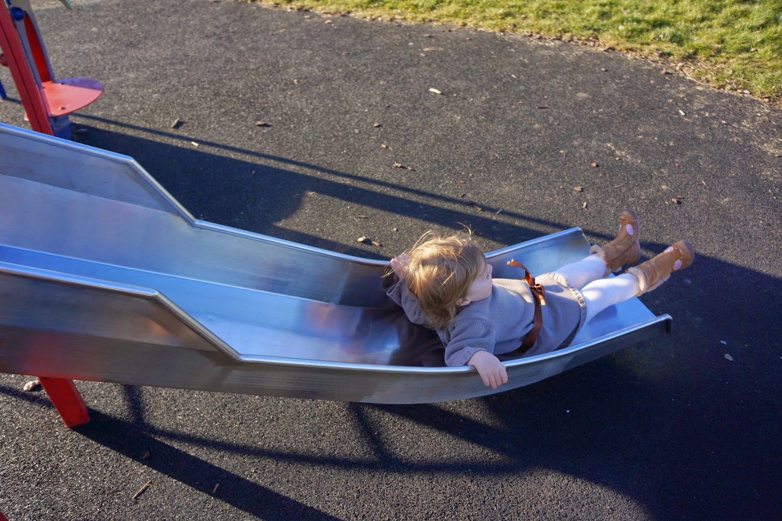 toddler on slide sliding down