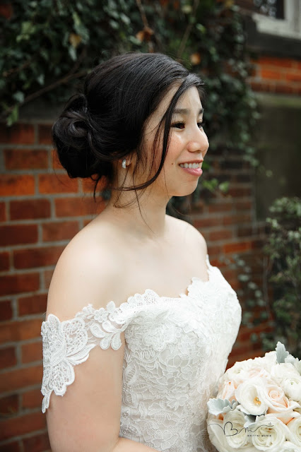 bridal portrait in front of ivory at Grosse Point Academy