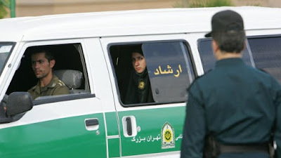 A policewoman looks out of a van of Iran's morality police in Tehran, Iran.