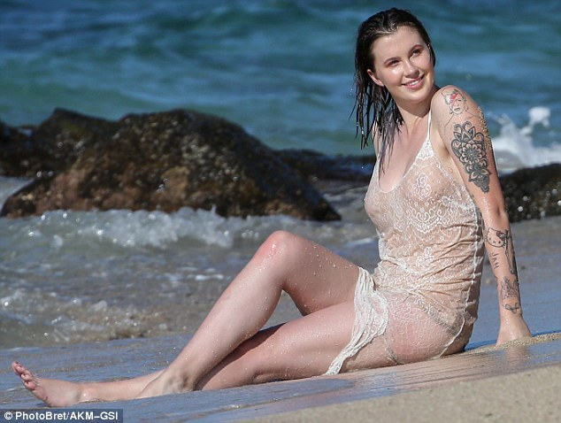 Ireland posed in the surf wearing nothing but a lacy nude negligee