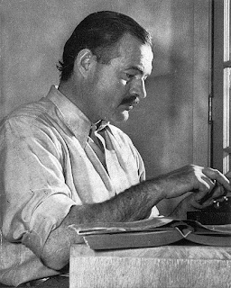"Hemingway posing for a dust jacket photo by Lloyd Arnold for the first edition of ""For Whom the Bell Tolls"", at the Sun Valley Lodge, Idaho, late 1939."