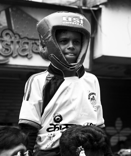 monochrome monday, black and white weekend, dadar, boy, top of human pyramid, break the pot, dahi handi, celebrations, krishna's birthday, mumbai, india,