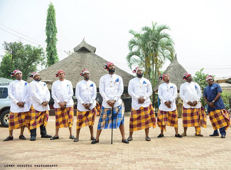 Groom and his men stand in formation in Igbo outfit