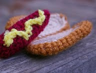 http://www.ravelry.com/patterns/library/mini-hot-dog-cat-toy