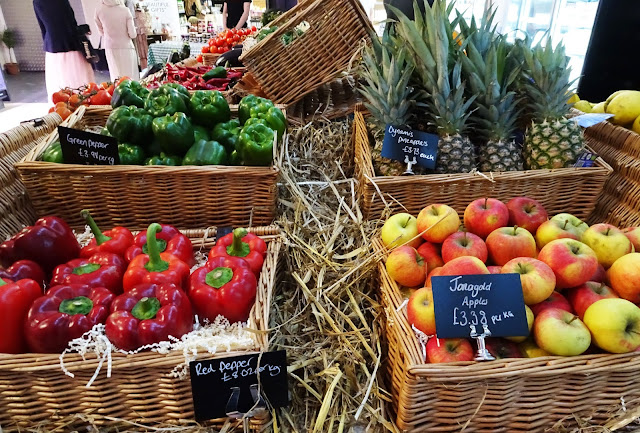 A range of fresh fruit and veg, including red peppers, apples, pineapples and green peppers