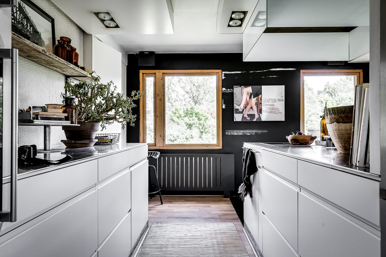 Kitchen in minimalist villa in white and gray with a simple decor