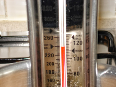 Sugar thermometer reaches soft ball or 235 degrees