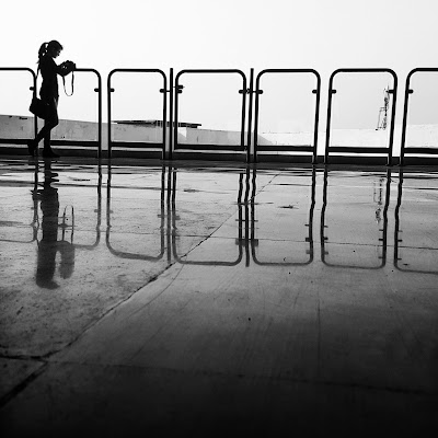 A Minimalist Photo of a little girl standing shot by Samsung Galaxy S6 Smart Phone