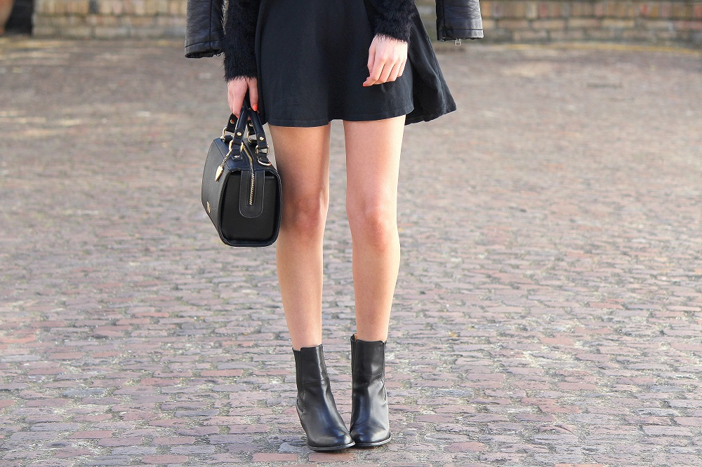 peexo fashion blogger wearing all black skater dress and ankle boots and box bag and sunglasses in spring