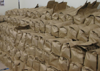 Bags of food packed and stacked on pallets, Sunnyvale Community Services, Sunnyvale, California