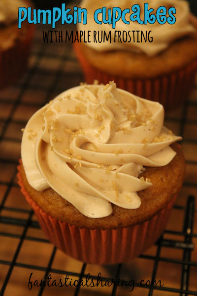 Pumpkin Cupcakes with Maple Rum Frosting // These delicious spiced cupcakes flavored with real pumpkin are topped with a decadent maple rum buttercream frosting! #dessert #cupcakes #pumpkin #maple #rum #recipe