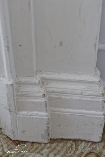 Antique fireplace mantel chipping paint details