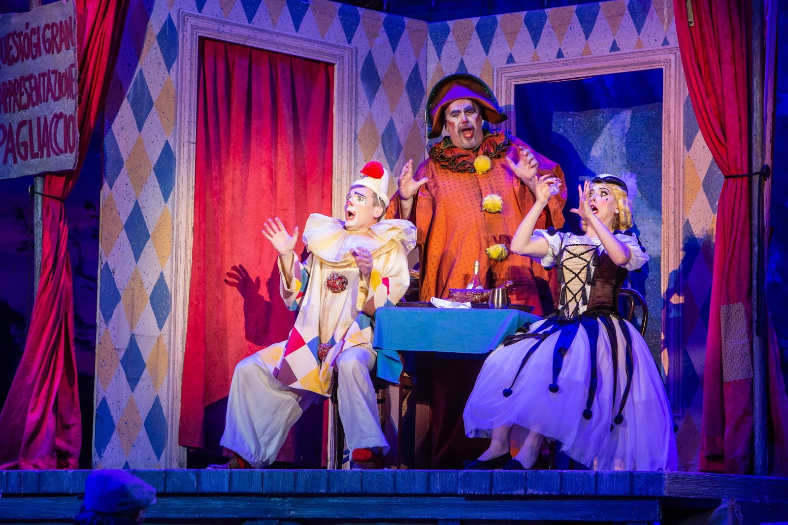 IN REVIEW: tenor JOEL SORENSEN as Beppe (left), baritone RICHARD ZELLER as Tonio (center), and soprano SUZANNE KANTORSKI as Nedda (right) in Greensboro Opera's November 2019 production of Ruggero Leoncavallo's PAGLIACCI [Photograph by Becky VanderVeen, © by VanderBeen Photography & Greensboro Opera]