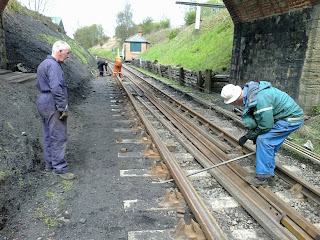 Rob helping to turn the last rail into the chairs